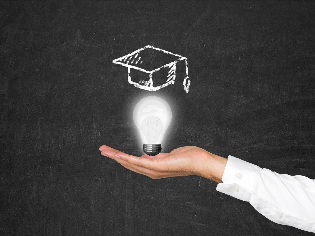 lightbulb with graduation cap drawn on top