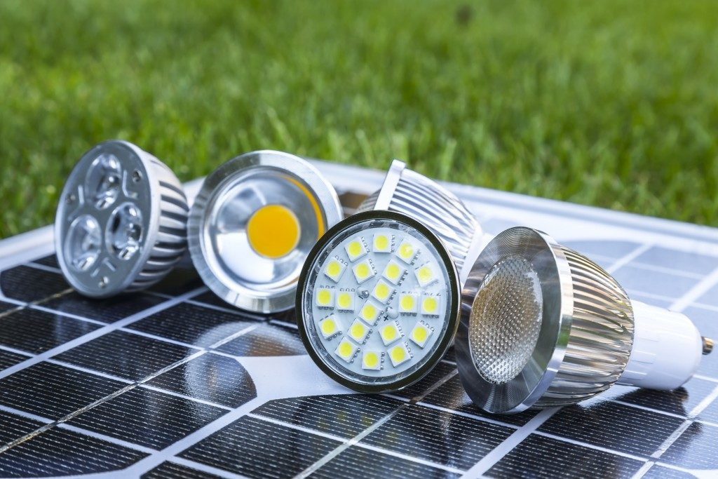 various GU10 LED bulbs on photovoltaics in the grass E27 LED and CFL bulbs