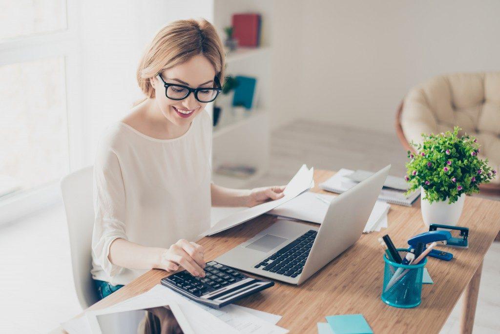 woman computing her finances