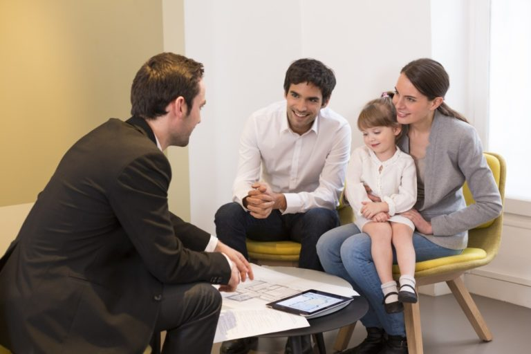 couple talking to a mortgage broker