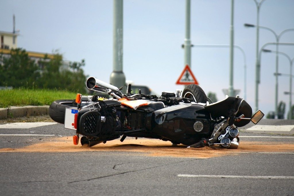 Motorcycle down on the road