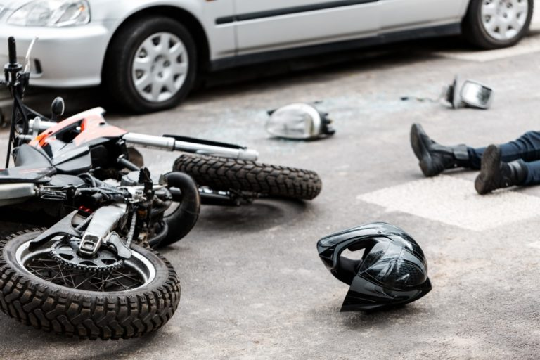 Motorcycle and driver down