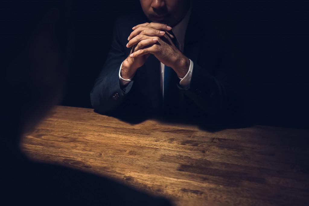 man being interrogated